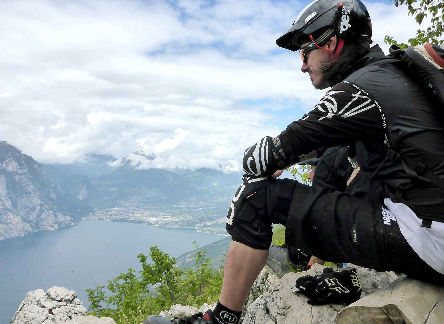 Andreas taking a break during mountain biking and enjoying his well earned view.